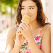Portrait of young happy woman eating ice-cream — Stock Photo #27555777