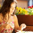 Stock Photo: Young summer woman eating dinner.