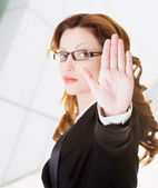 Serious business woman gesturing stop — Stock Photo