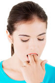 Woman putting her finger in her mouth to provoke vomiting — Stock Photo