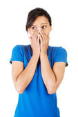 Young scared woman covering the mouth — Foto Stock