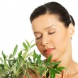 Woman with health skin and with olive tree — Stock Photo