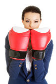Young businesswoman with boxing gloves — Stock Photo