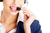 Pretty call-centre assistant smiling at the camera — Stock Photo