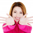Woman pointing with both hands towards the camera — Stock Photo