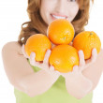 Happy woman with orange fruits — Stock Photo