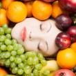 Woman face in fruits — Stock Photo