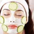 Woman with cucumber slices on the face — Stock Photo