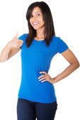 Beautiful woman showing her thumb up — Stock Photo