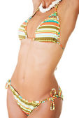 Beautiful young woman's body in bikini. — Stock Photo