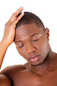 Young handsome man with headache. — Stock Photo