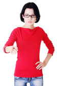 Attractive woman pointing down with eyeglasses. — Stock Photo
