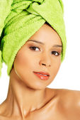 Portrait of beautiful naked woman with turban. — Stock Photo
