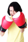 Attractive young woman with boxing gloves. — Stockfoto