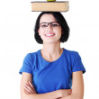 Attractive woman with book and apple on head. — Stock Photo