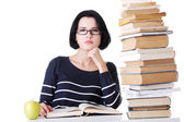 Arrtactive young woman sitting next to stack of book — Stockfoto