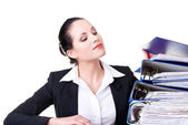 Business woman with stack of binders. — Stock Photo