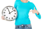 Attractive woman with a clock. Close up. Bodypart. — Stock Photo
