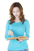 Attractive casual woman with book pointing on text. — Stock Photo