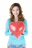 Attractive casual woman holding heart balloon. — Stock Photo