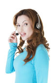 Attractive casual woman with headphones and microphone. — Stock Photo