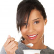 Young woman eating yogurt as healthy breakfast or snack. — Stock Photo