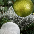 Two chriustmas balls hangind on a tree. — Stock Photo #36005447