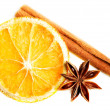 Slice of orange, star anise and cinnamon. — Стоковая фотография