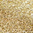 Gold pieces of confetti. — Stock Photo