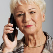 An old lady with mobile phone. — Stock Photo