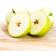 Green apples divided into two half. — Stock Photo
