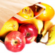 Apples,kaki and pears lying on the floor in paper bag. — Stock Photo #36002649