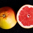 Fresh grapefruit divided into two pieces. — Stock Photo #36002971