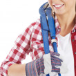 Casual woman in safety helmet and plumber wrench. — Stock Photo