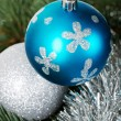 Two chriustmas balls hangind on a tree. — Stock Photo #36005423