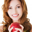 Attractive casual woman holding an apple. — Stock Photo #36006813