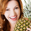 Attractive woman with pineapple. — Stock Photo #36006855
