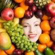 Woman face in fruits. — Stock Photo