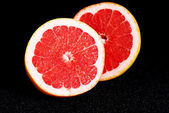 Fresh grapefruit divided into two pieces. — Stock Photo