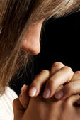 Young woman praying, close up. — Stock Photo