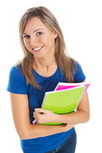 Young happy and satisfied student holding workbook. — Stock Photo