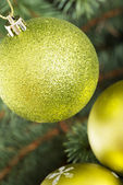 Three christmas balls hanging on christmas tree. — Stock Photo