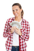 Young woman holding a large sum of money. — Stok fotoğraf