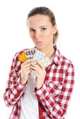 Young casual woman holding pills. — Stock Photo