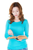 Attractive casual woman with book pointing on text. — 图库照片