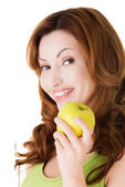 Attractive casual woman holding an apple. — Stok fotoğraf
