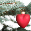 One separated christmas ball handing on a twig. — Stock Photo