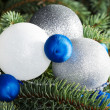 Three christmas balls on a tree. — Foto de Stock