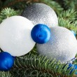 Three christmas balls on a tree. — Stockfoto