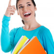 Young happy female student is pointing up and holding workbooks. — Stock Photo